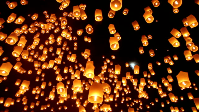 Sky Lanterns During Yee Peng Festival in Chiang Mai Thailand Sky lanterns floating in the night at the Loy Krathong festival in Chiang Mai, Thailand. moving up stock videos & royalty-free footage