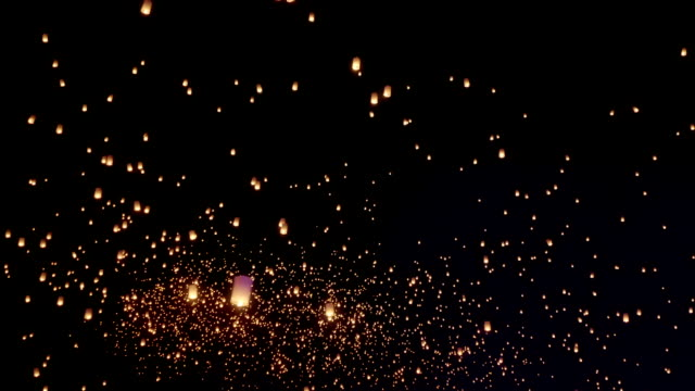 Sky Lanterns Flies Into The Night Sky Thousands of sky lanterns are released into the night sky to wish for good luck as part of a lantern festival. lantern stock videos & royalty-free footage