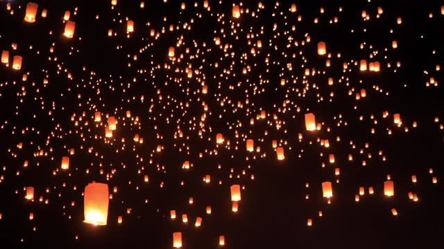 Sky Lanterns Fly Into The Night Sky Thousands of glowing sky lanterns are released into the night sky to wish for good luck as part of a lantern festival. hope concept stock videos & royalty-free footage