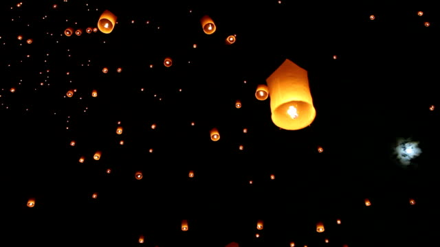 Sky Lanterns for Yee Peng Festival in Chiang Mai Thailand Floating lanterns during the Loy Krathong festival in Chiang Mai, Thailand. lantern stock videos & royalty-free footage