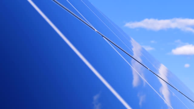 Sky reflection on the surface of a solar farm. Sky reflection on the surface of a solar array. 4K durability stock videos & royalty-free footage