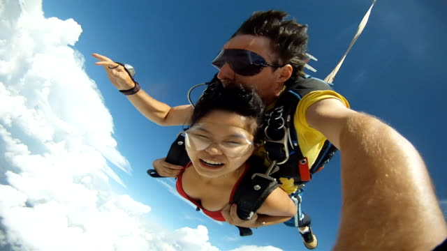 Skydive Tandem Selfie asian gril Above the clouds diving to the ground stock videos & royalty-free footage