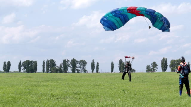 Skydiver lands on the field.