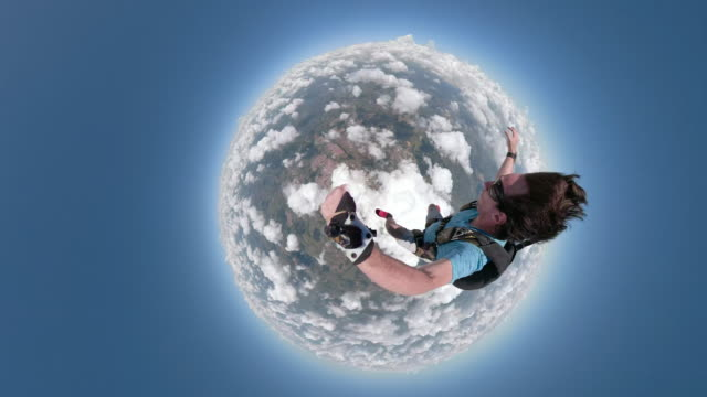 skydiver making a amazing selfie video in free fall - fish eye video stock e b–roll