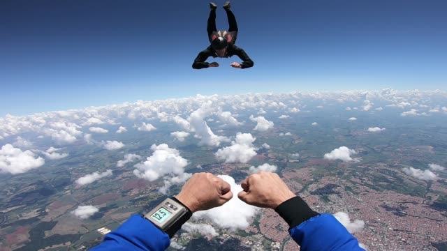 Skydiver point of view of his student