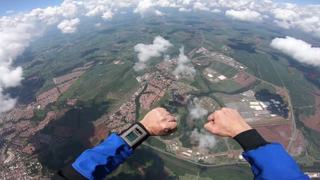 Skydiver point of view of his student point of view diving to the ground stock videos & royalty-free footage