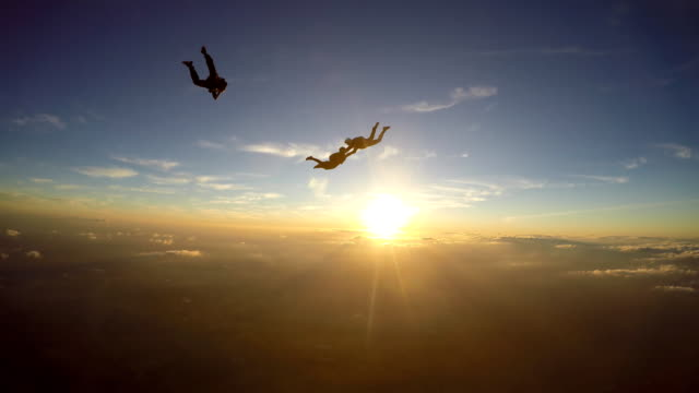 Skydivers having at the amazing sunset 4K video