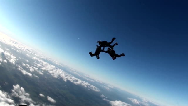 Skydivers jump from an airplane video