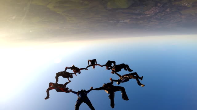 skydiving friends at the sunset - team video stock e b–roll