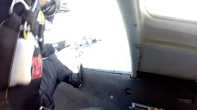 Skydiving pov group exit from the plane point of view diving to the ground stock videos & royalty-free footage