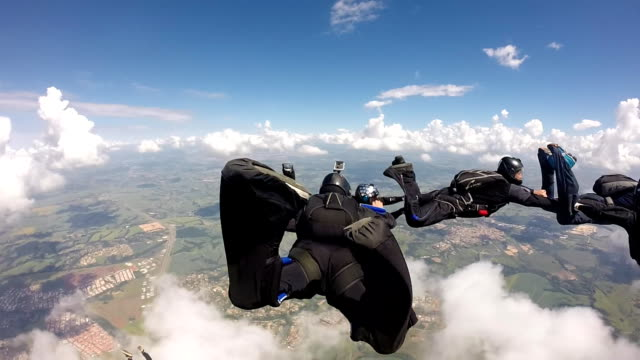 Skydiving pov group point of view diving to the ground stock videos & royalty-free footage