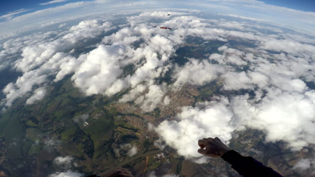 Skydiving pov group 4 resolution point of view diving to the ground stock videos & royalty-free footage