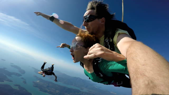Skydiving tandem selfie 4K Rio de Janeiro - Brazil diving to the ground stock videos & royalty-free footage