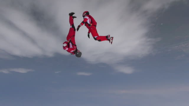 Skydiving video. The concept of active recreation. Skidiver rotates in free fall. Extreme sport concept. diving to the ground stock videos & royalty-free footage