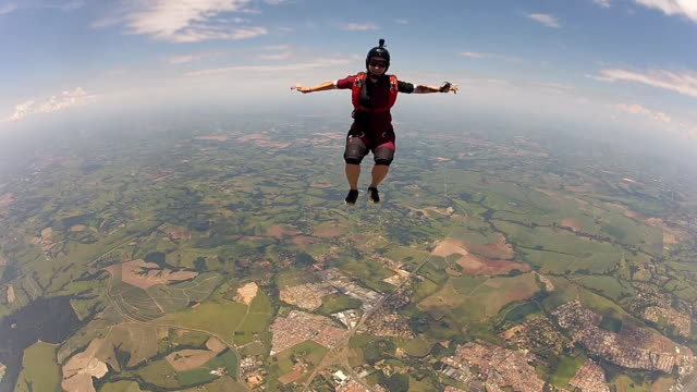 Skydiving woman sit fly Skydiving woman sit fly diving to the ground stock videos & royalty-free footage