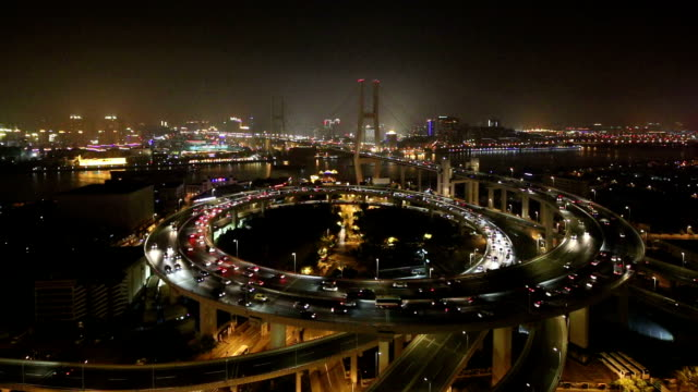 skyline and busy traffic on elevated road intersection at night, time lapse. video