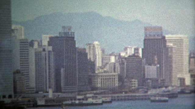HONG KONG 1973: Skyline from the harbor shows off the architecture of the time. video