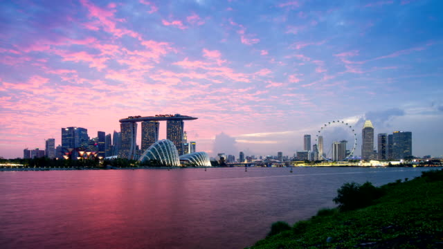 Skyline of Marina Bay, Singapore Skyline of Marina Bay in Timelapse during dusk hour, includes Garden by the Bay, Marina Bay Sand Hotel, CBD skyscrapers, ArtScience Museum and Singapore flyer, The Ritz-Carlton Millenia Singapore, Pan Pacific Hotel Singapore, Millenia Tower in background. singapore architecture stock videos & royalty-free footage