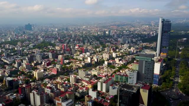 skyline of mexico city aeria - город мехико стоковые видео и кадры b-roll