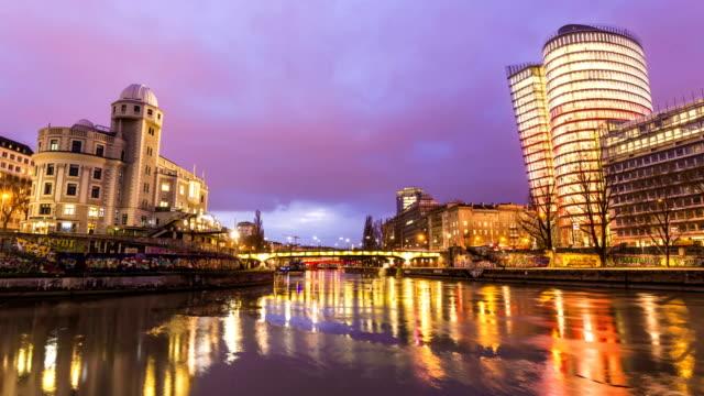 Skyline Vienna with bridge by sunset, time lapse video