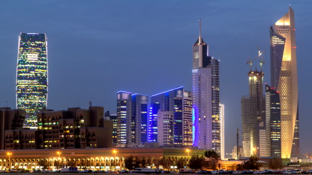 Skyline with Skyscrapers day to night timelapse in Kuwait City downtown illuminated at dusk. Kuwait City, Middle East video