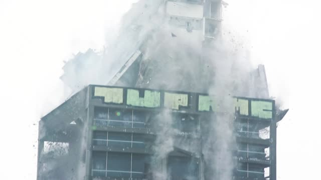 Skyscraper Demolition Blast in Real Time Skyscraper demolition blast. Building collapsing in real time. demolishing stock videos & royalty-free footage