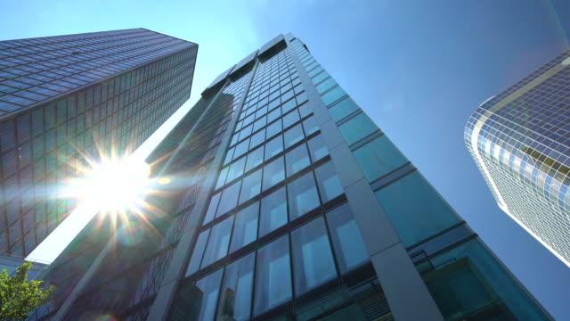 Skyscraper in Frankfurt with sun Skyscraper in Frankfurt office park stock videos & royalty-free footage