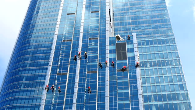 Skyscraper with window cleaners video