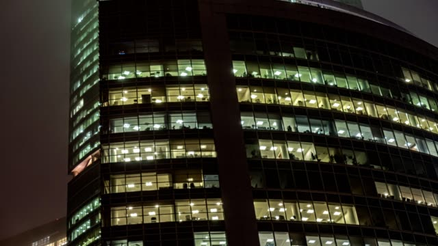 skyscrapers and office windows of the business center in a foggy evening, time lapse, hyper lapse - quartiere generale video stock e b–roll