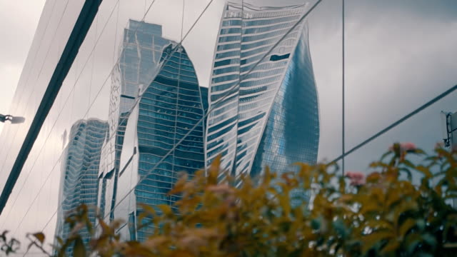 Skyscrapers business center Moscow City are reflected from the glass surface video