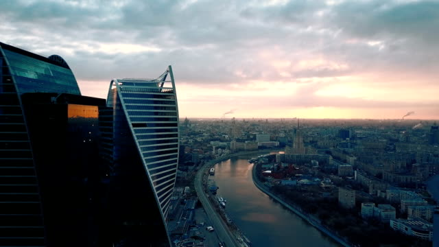 skyscrapers skyline at sunset - contemporary architecture stock videos & royalty-free footage