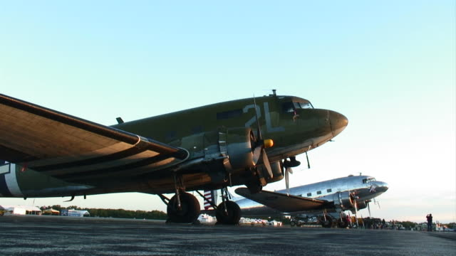 C47 Skytrains at Sunrise Two Douglas A-47's sitting on an airfield as the sun comes up. airfield stock videos & royalty-free footage