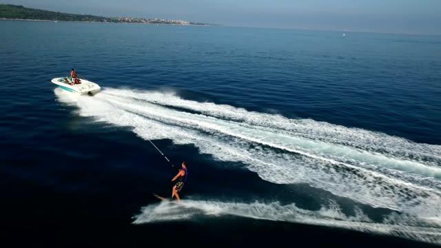 Slalom waterskiing - aerial shot from behind video