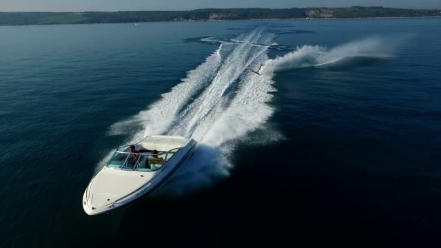 Slalom waterskiing - aerial shot from front video