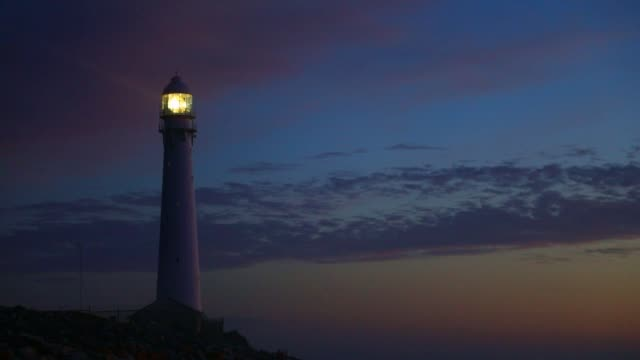 Slangkop Lighthouse near the town of Kommetjie in Cape Town, South Africa at Sunset