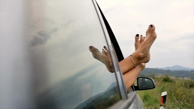 sleeping in the car on the road,human legs - sorriso aperto video stock e b–roll