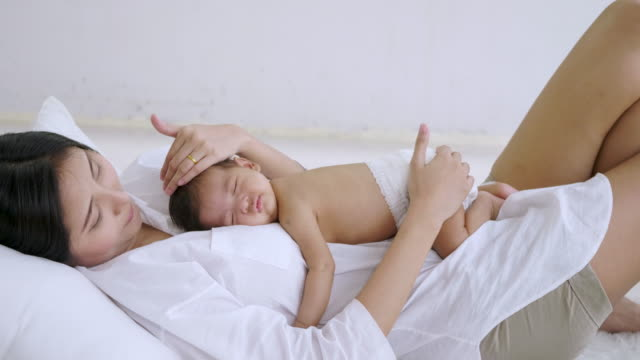 Sleeping newborn baby on mother's body video