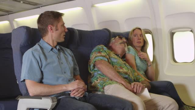 sleeping passenger on plane - pasażer filmów i materiałów b-roll