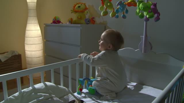 HD CRANE: Sleepless Baby Climbing Out Of Crib video