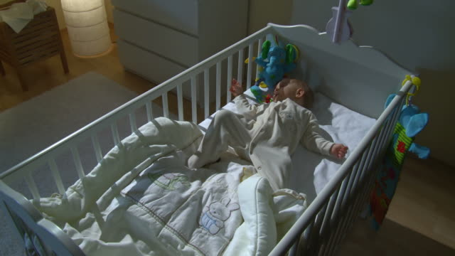 HD CRANE: Sleepless Baby Crying In Her Bed video