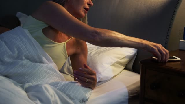 Sleepless Senior Woman In Bed At Night Using Mobile Phone Sleepless Senior Woman In Bed At Night Using Mobile Phone insomnia stock videos & royalty-free footage