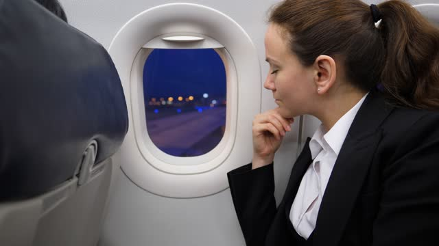 Sleepy passenger woman sit with eyes closed, wait for plane departure