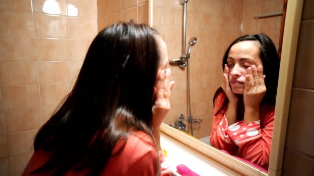 sleepy woman in the bathroom - stanco video stock e b–roll