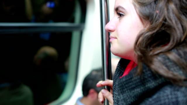 sleepy donna che viaggiano all'interno della metropolitana - cultura turca video stock e b–roll