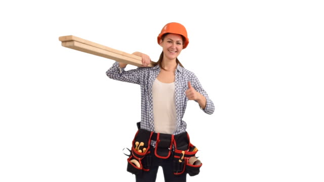 slender young woman construction worker with boards showing the thumbs up video