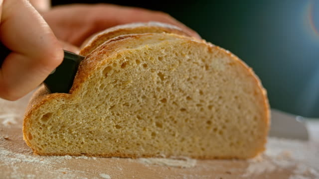SLO MO LD A slice of corn bread being cut