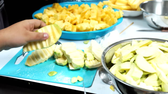 Slice of pineapple and green mango for sale video