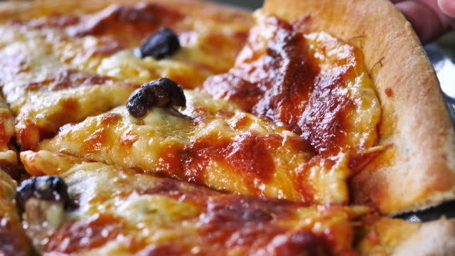 Slice of pizza Slice of pizza indulgence stock videos & royalty-free footage