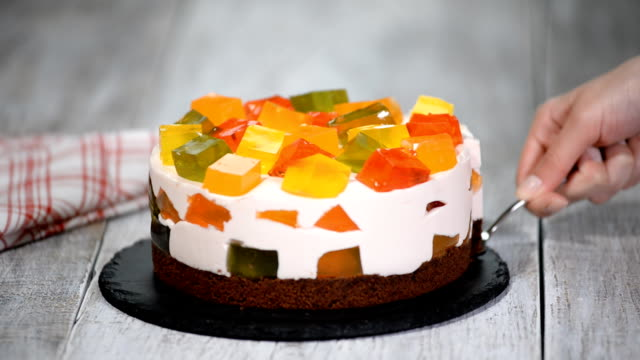 Slice of the cake with colorful fruity jelly pieces. Slice of the cake with colorful fruity jelly pieces. jello stock videos & royalty-free footage