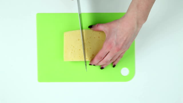 Slice the cheese into pieces video
